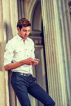 Alexander Image - Young American Businessman texting outside in New York