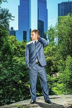Alexander Image - Young American Businessman traveling, working in New York, takin