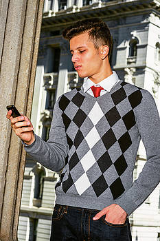 Alexander Image - Young American Man texting outside in New York