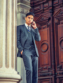 Alexander Image - Young Asian American Business Man talking on cell phone outside