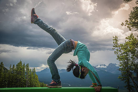 Young asian girl in bridge pose at Lake Louise Area by William Freebilly photography