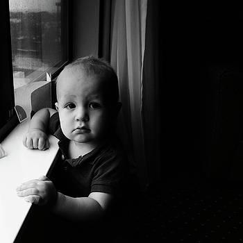 Young Boy at Hotel Window by Joseph Duba