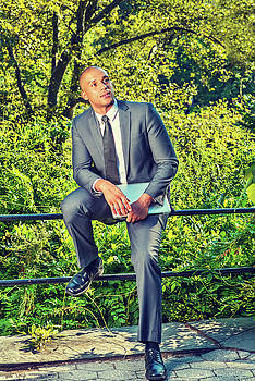 Alexander Image - Young businessman relaxing outside