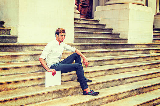 Alexander Image - Young Businessman sitting on stairs, relaxing outside