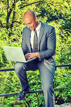 Alexander Image - Young Businessman working outside