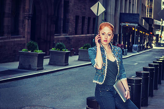 Alexander Image - Young Businesswoman calling outside