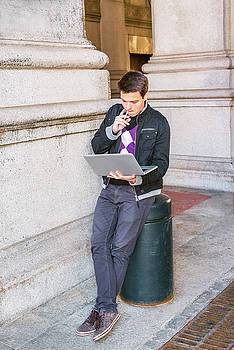 Young college student studying on street in New York 15042520 by Alexander Image