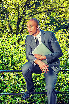 Alexander Image - Young European Businessman relaxing outside in New York