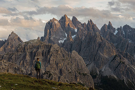 Young female enjoys sunset in the Dolomites mountains, Italy, Europe by Blaz Gvajc