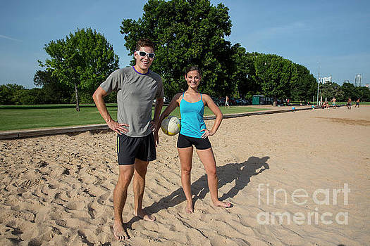 Herronstock Prints - Young happy athletic couple with volleyball Zilker Park volleyball courts