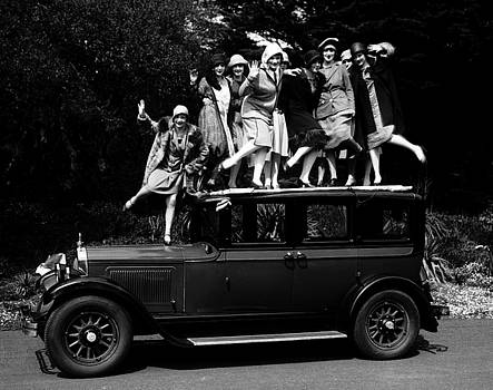 Peter Gumaer Ogden - Young Ladies Dancing the Charleston on top of a Willys Knight Motorcar 1926