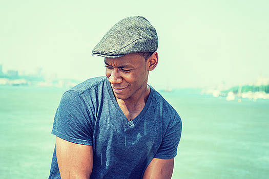 Alexander Image - Young Man relaxing by lake