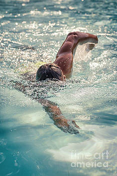 Young man swimming by Pier Giorgio Mariani