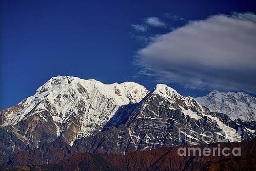 Annapurna South Peak and pass in the Himalaya mountains, Annapurna region, Nepal by Raimond Klavins