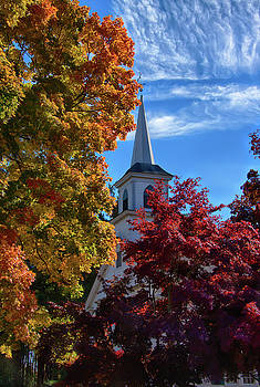 Church with Mares tails above and fall foliage below by Jeff Folger