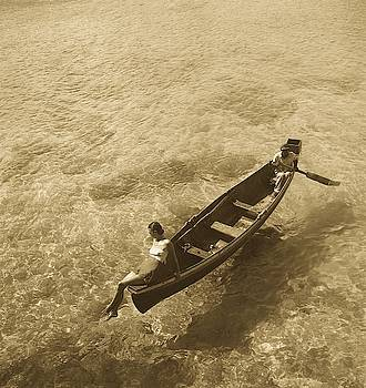 Fashion Model On Edge Of Boat, Man Rowing, Montego Bay, Jamaica by Toni Frissell