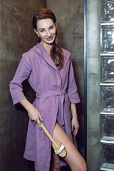 Girl Stands In The Bathroom In A Purple Robe by Elena Saulich
