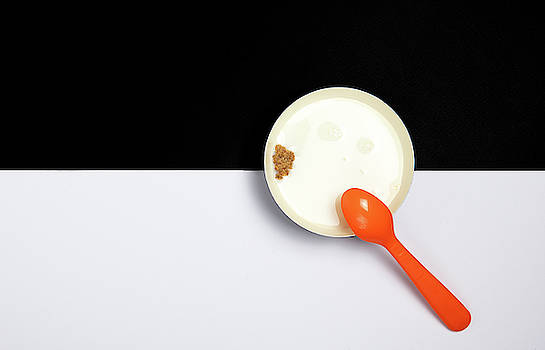 Healthy breakfast with Ceramic bowl filled with milk and a piece by Michalakis Ppalis