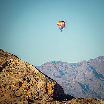 Hot Air Balloon Flying Above Red Rock Canyon by Alex Grichenko