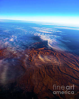Looking Down at Altostratus Clouds From 24K Feet by Joe Kunzler