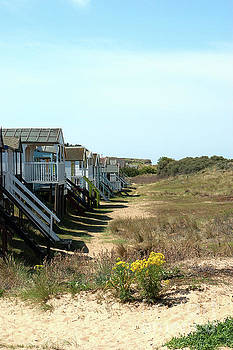 Norfolk beach huts by John Edwards