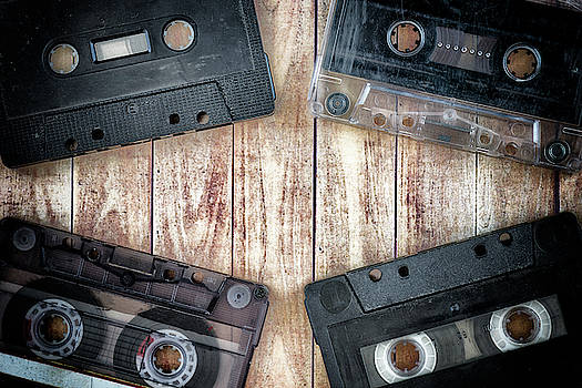 Old cassette tapes with a wooden background by Vicen Photography