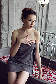 sexy young girl in grey Terry towel sitting by Elena Saulich