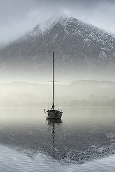 Stunning landscape image of sailing yacht sitting still in calm  by Matthew Gibson