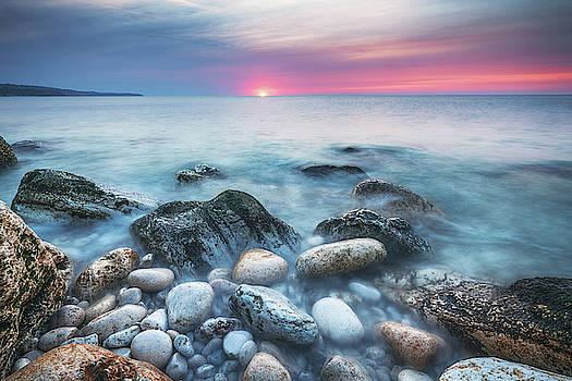 Sunrise over the beach by Valentin Valkov