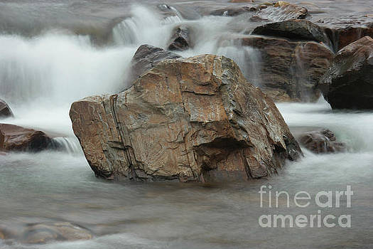 Water and rocks by Jeff Swan