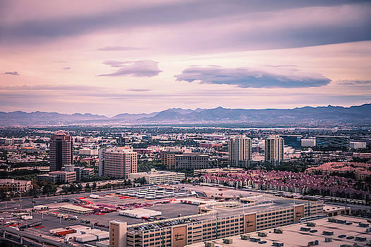 Las vegas city surrounded by red rock mountains and valley of fi by Alex Grichenko