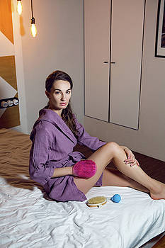 Girl In A Purple Robe Doing A Foot Massage by Elena Saulich