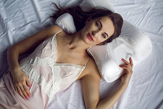 Young Woman In A Nightgown Lying In A White Bed by Elena Saulich