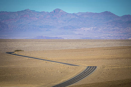 Lonely Road In Death Valley National Park In California by Alex Grichenko