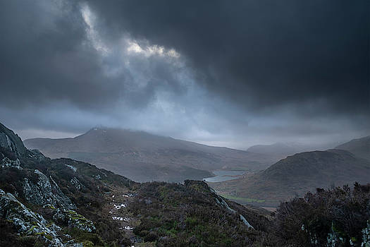 Moody and dramatic Winter landscape image of Moel Saibod from Cr by Matthew Gibson
