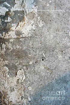 Weathered stone wall by Tom Gowanlock