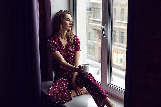 Young Woman In Red Pajamas Sitting In The Morning On The Windowsill by Elena Saulich