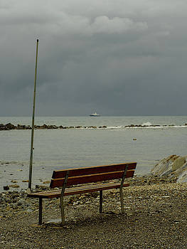 A bench on which to expect, by the sea by Giovanni Bertagna