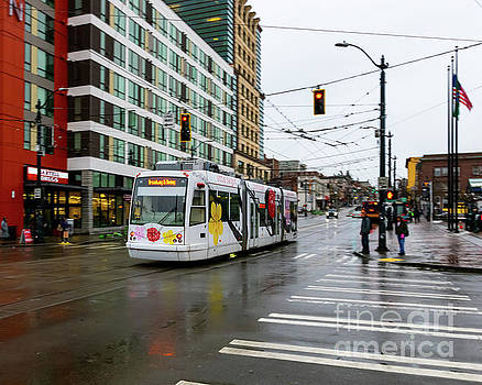 A Colorful Seattle Streetcar in the Rain by Joe Kunzler