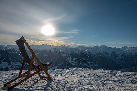 A Deckchair Stands On A Mountain Overlooking The Valley  by Karsten Eggert