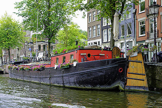 A Houseboat On A Canal In Amsterdam by Richard Rosenshein