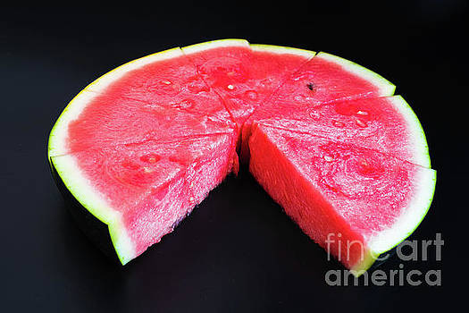 A large slice of watermelon divided into smaller pieces, flat, r by Joaquin Corbalan