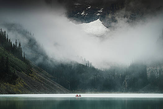 A misty morning at the Lake Louise in Banff National Park in Canada by Kamran Ali