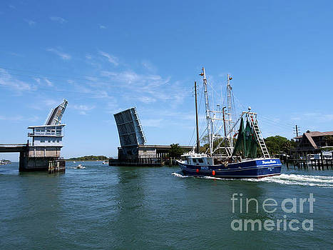 A shrimp trawler passes the open Wrightsville Beach Bridge by Louise Heusinkveld