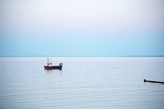 A Small Fishing Boat On The Sea by Karsten Eggert