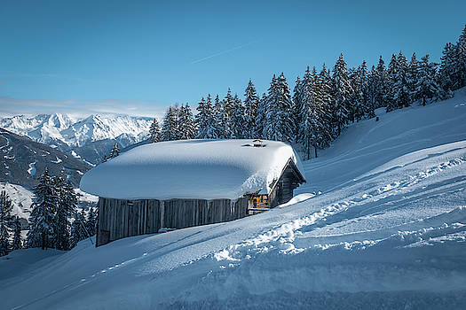 A Snow-covered Wooden House In The Mountains  by Karsten Eggert