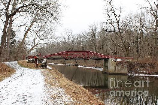 A Winter View of a Red Camelback Bridge by Anne Ditmars