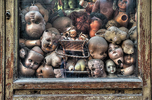 Abandoned doll heads by Ian Robert Knight