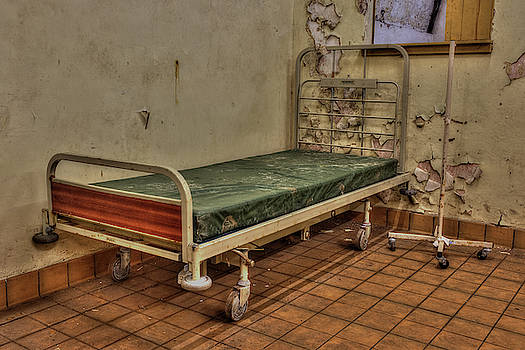 Abandoned hospital bed by Steev Stamford