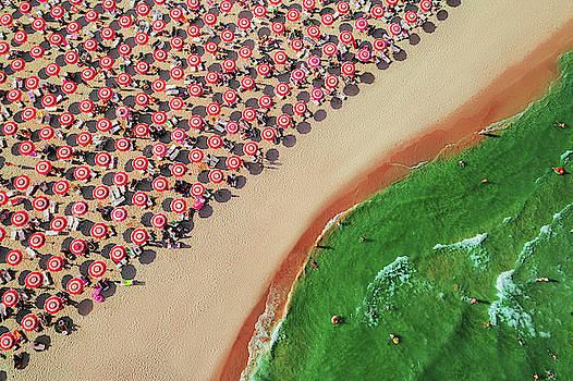 Aerial top view on the beach. Umbrellas, sand and sea waves by Valentin Valkov